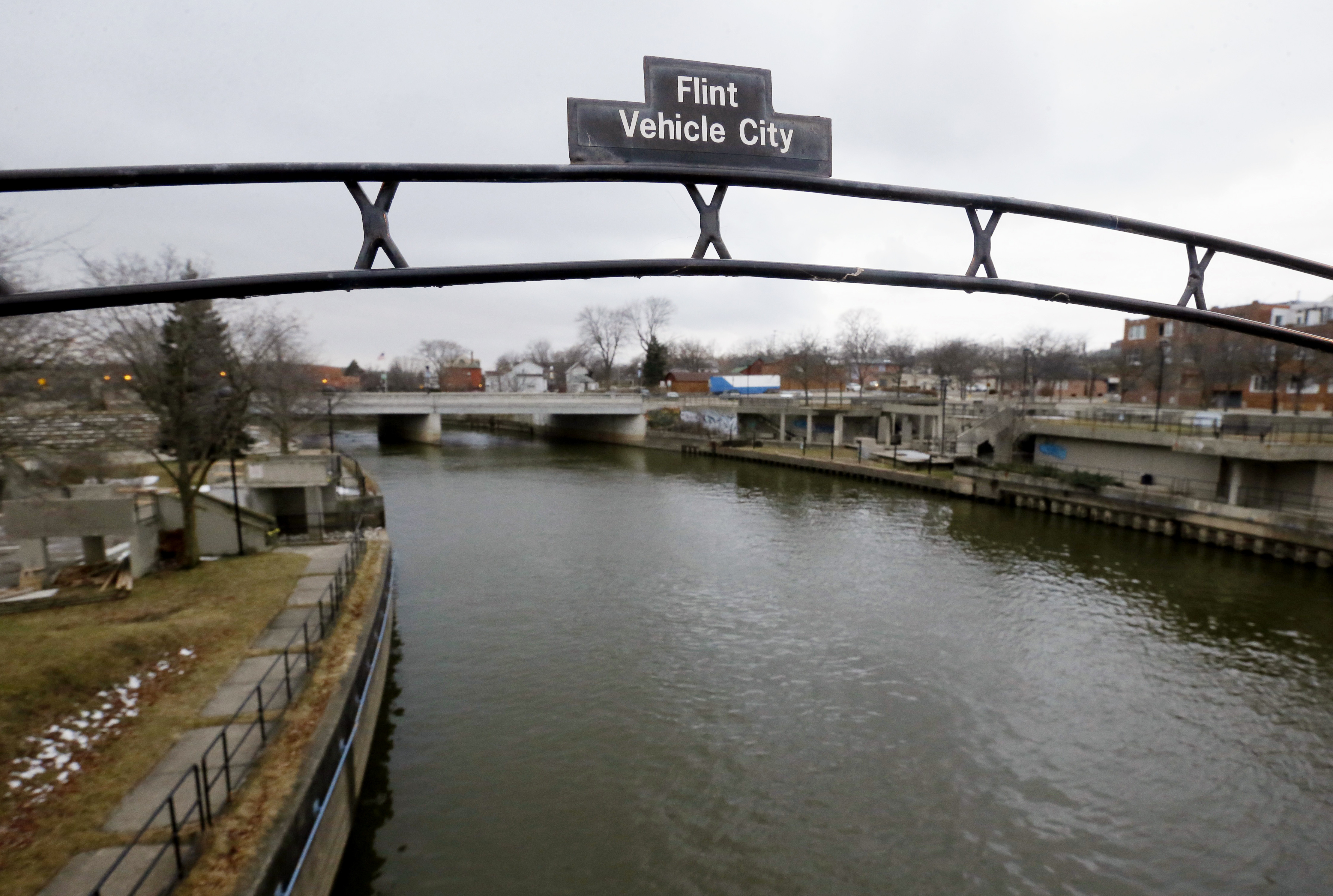 A sign over the Flint River in Flint, Mich. in January 2016. Carlos Osorio/AP