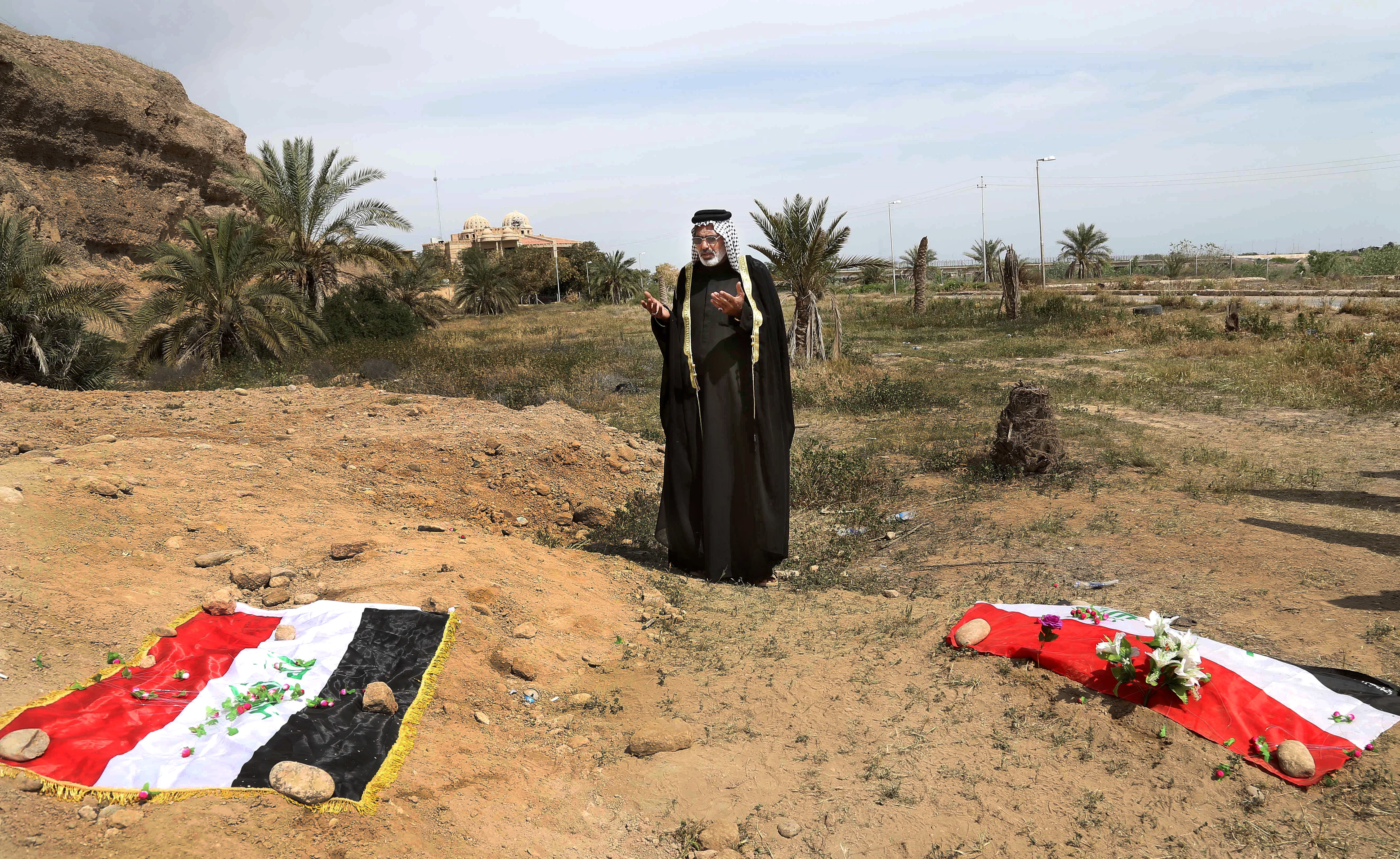 An Iraqi man prays in 2015 for his slain relative, at the site of a mass grave, believed to contain the bodies of Iraqi soldiers killed by Islamic State group militants when they overran Camp Speicher military base, in Tikrit, Iraq. Khalid Mohammed/AP