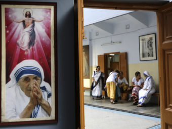 Catholic nuns attend visitors at the Missionaries of Charity house in Kolkata on Aug. 26. (Photo by Bikas Das/Associated Press)