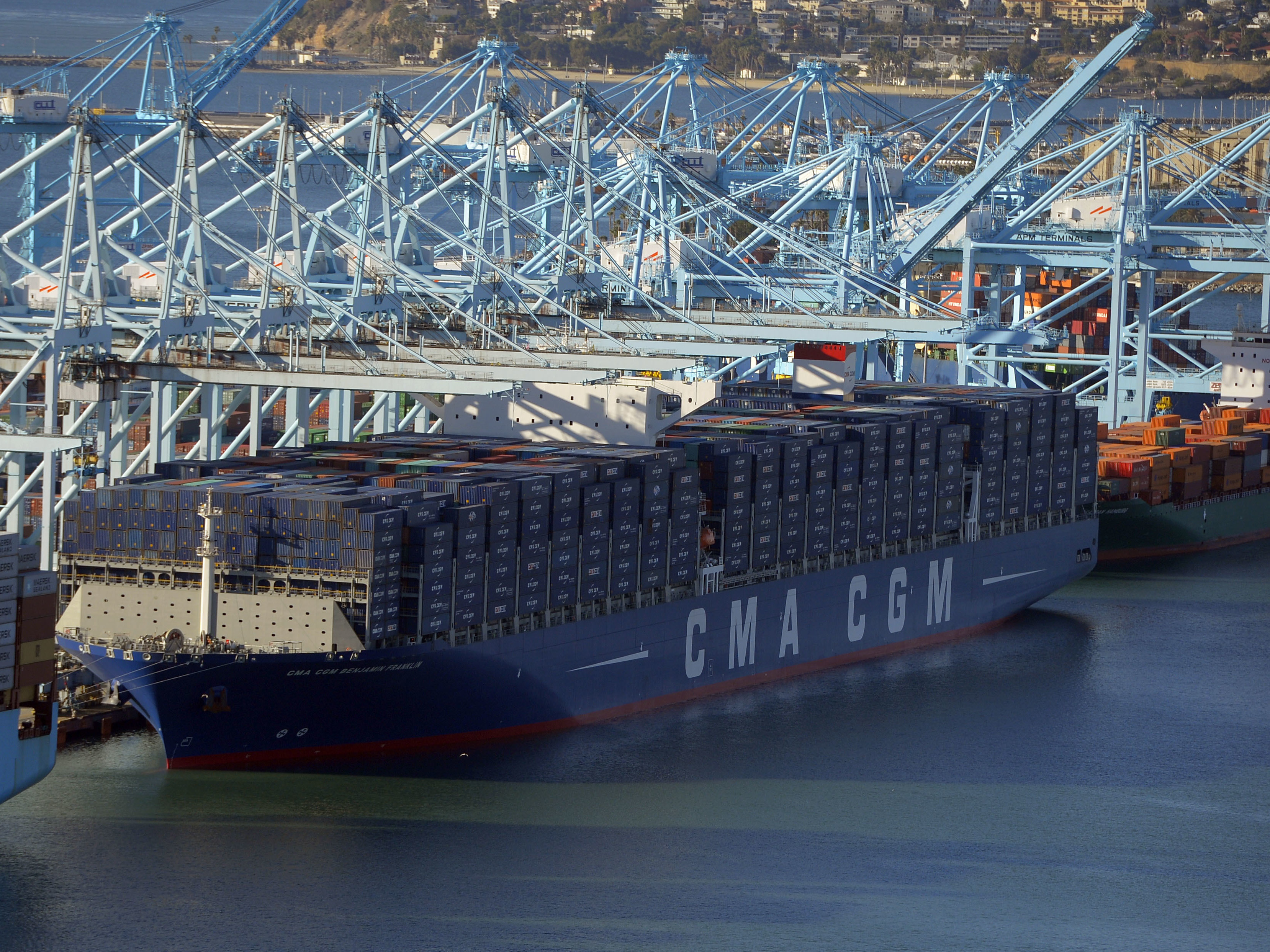 After its maiden voyage from China, the largest container ship to ever make port in North America, unloads its cargo in the Port of Los Angeles on Dec. 26, 2015. The major shipping companies in Europe and Asia began ordering the state-of-the-art, supersized ships back in 2011, when times were better. Scott Varley/AP