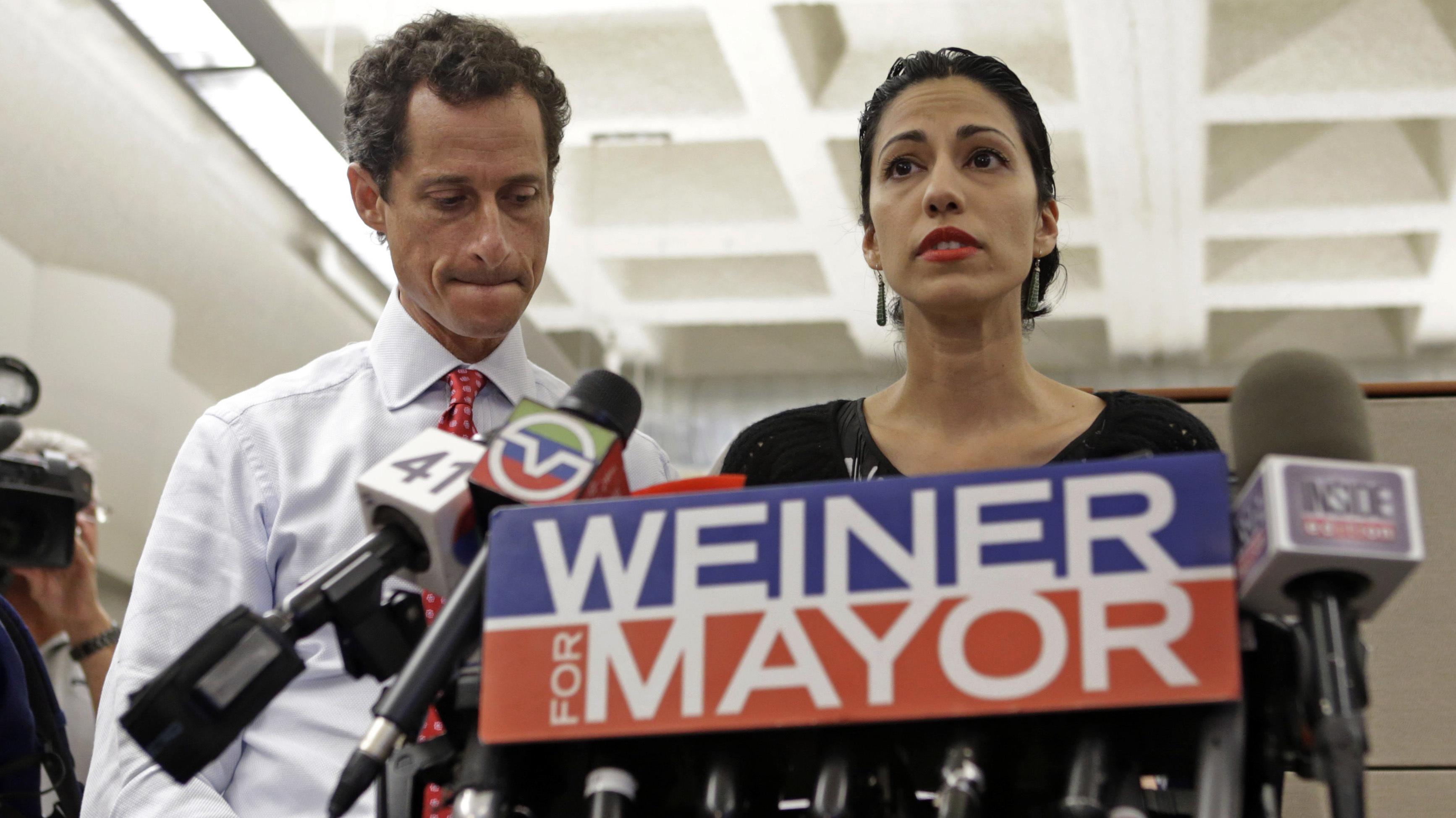 Anthony Weiner (left) and Huma Abedin at a news conference in 2013 during Weiner's mayoral campaign. (Photo by Kathy Willens/Associated Press)