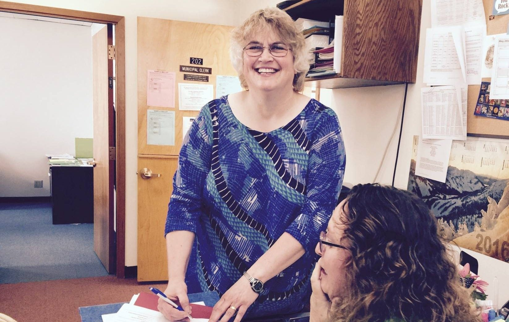 Beth Weldon files her paperwork to run for Juneau Assembly, District 2 at Deputy City Clerk Beth McEwen's desk, Aug. 5, 2016. (Photo courtesy Beth Weldon for Assembly)