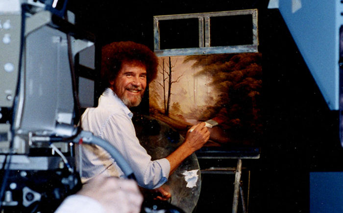 Ross filmed more than 400 episodes of The Joy of Painting. He actually painted three different versions of each work for every show — but viewers only saw the one on screen. (File photo by Bob Ross Inc.)