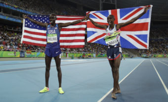 American Paul Chelimo (left), a member of the U.S. Army, celebrates his silver medal in the men's 5,000 meters along with the winner, Mo Farah of Britain. Chelimo was disqualified shortly afterward, but his second-place finish was later reinstated. Matt Slocum/AP