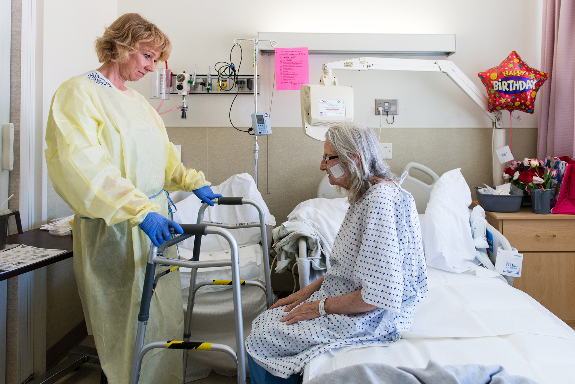 Nurse specialist Annelie Nilsson checks on patient Janet Prochazka, during her stay at the Zuckerberg San Francisco General Hospital, after Prochazka took a bad fall in March.