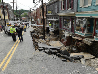 Rescue workers on Sunday look at the destruction caused by a flash flood on Main Street in Ellicott City, Md. The Washington Post/Getty Images
