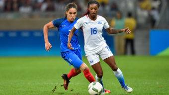 U.S. women's soccer player Crystal Dunn (in white) contends with Amel Majri of France during their match at Mineirao Stadium in Belo Horizonte, Brazil. The U.S. earned a 1-0 victory in the the Group G first-round meeting in the Rio Summer Olympics tournament. Pedro Vilela/Getty Images