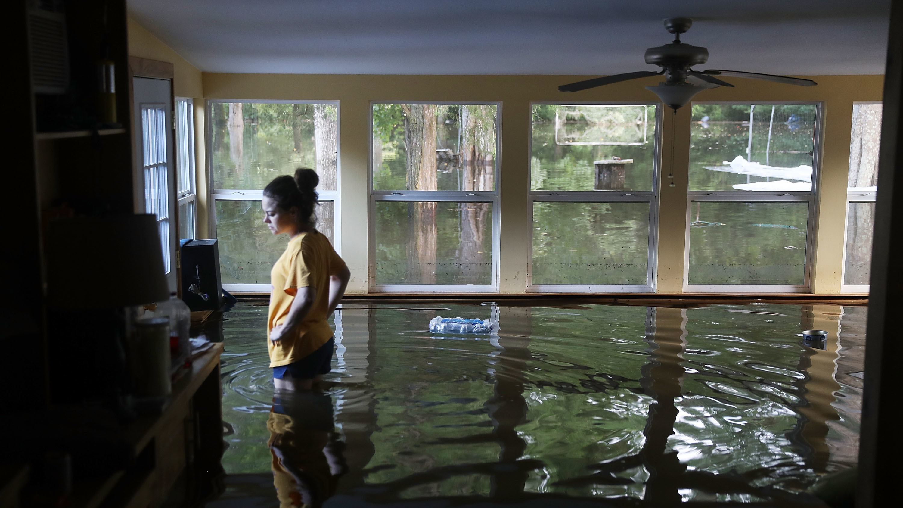Leslie Andermann Gallagher surveys the flood damage to her home in Sorrento, La., on Wednesday. (Photo by Joe Raedle/Getty Images)