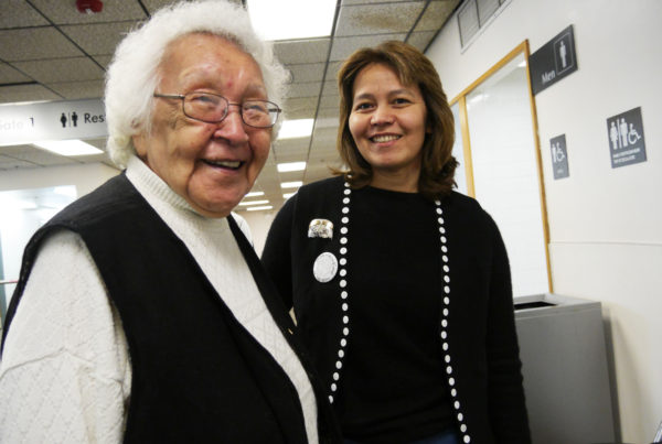 Tribal elder Lillian Austin stands with Valerie Hillman at Juneau International Airport on Thursday, Aug. 25, 2016. Both women were on their way to the Huna Tribal House dedication ceremonies in Glacier Bay National Park and Preserve, but held up by weather. (Photo by Lakeidra Chavis/KTOO)