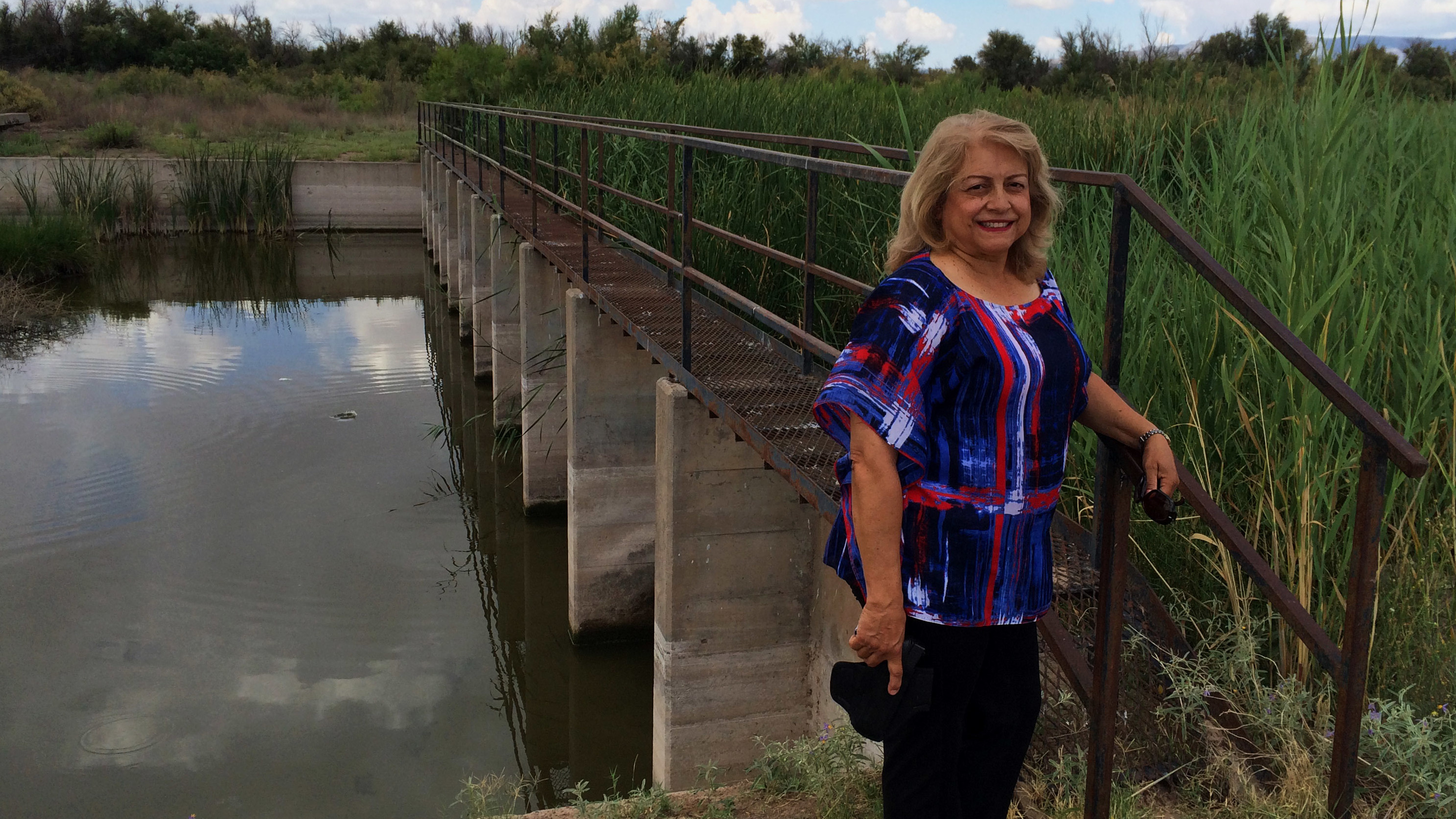 Lupe Dempsey, a retired federal agent, brings her Glock 9mm with her when she goes down to the Rio Grande. She believes the border is too wide open, evidenced by this unguarded metal walkway across the river in far West Texas. (John Burnett, NPR)