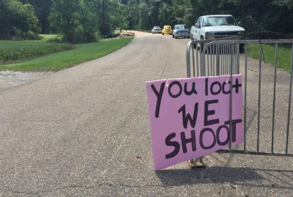 A handmade sign offers a stern warning at the entrance to an abandoned neighborhood where people have lost so much. (Kirk Siegler/NPR)