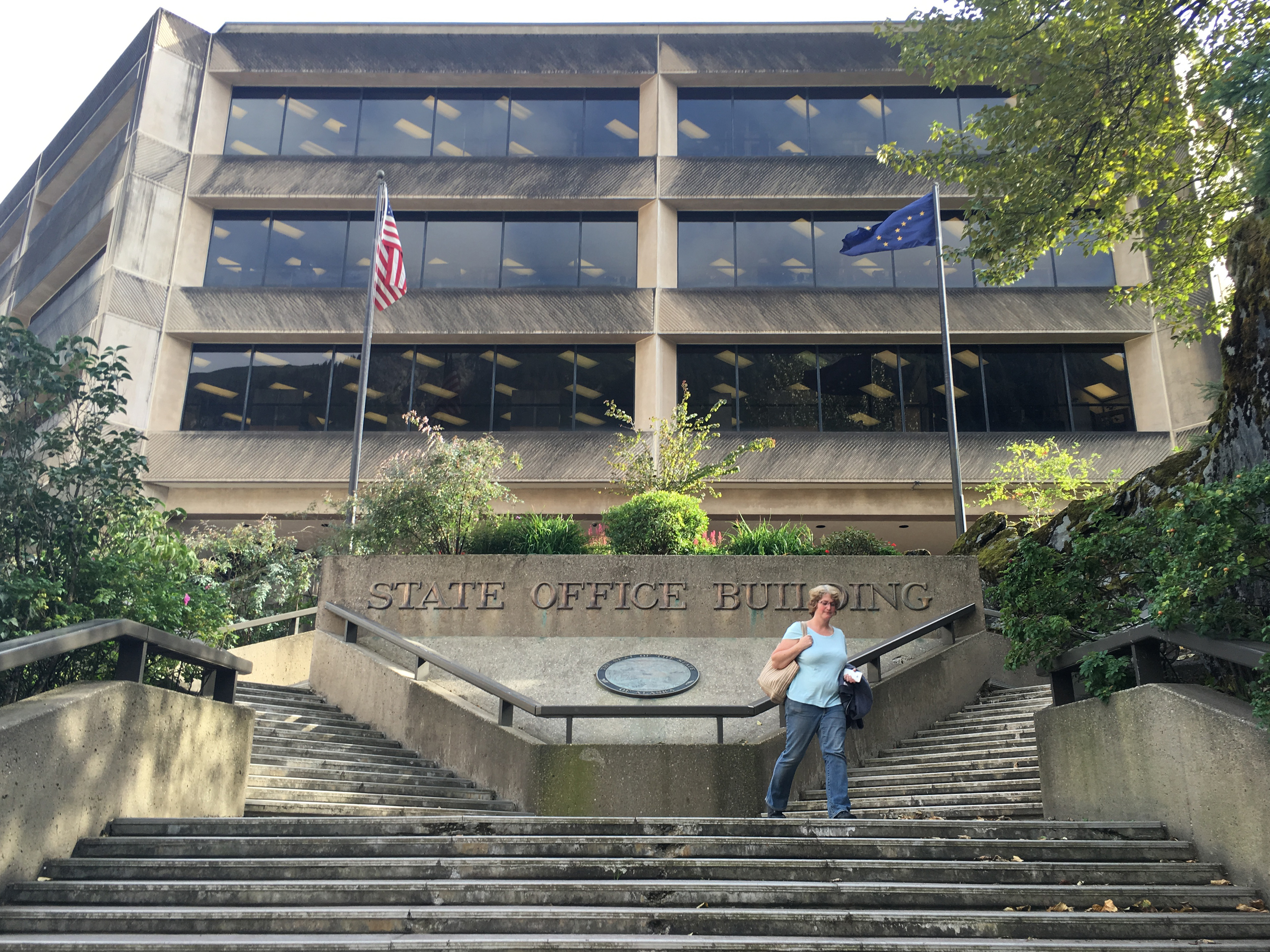 State and local government workers receive similar compensation to priv-ate-sector workers, according to an Institute of Social and Economic Research report. State Office Building. Aug. 5, 2016.(Photo by Andrew Kitchenman/KTOO)