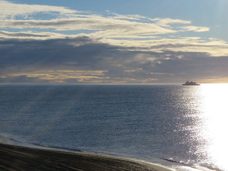 The U.S. Coast Guard icebreaker, Healy, sits just offshore of Barrow, shortly before setting sail on Arctic Shield 2013.