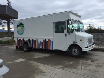 The Friends of the Homer Library introduced a new bookmobile on Saturday, Sept. 17. (Photo by Casey Marsh/KBBI)