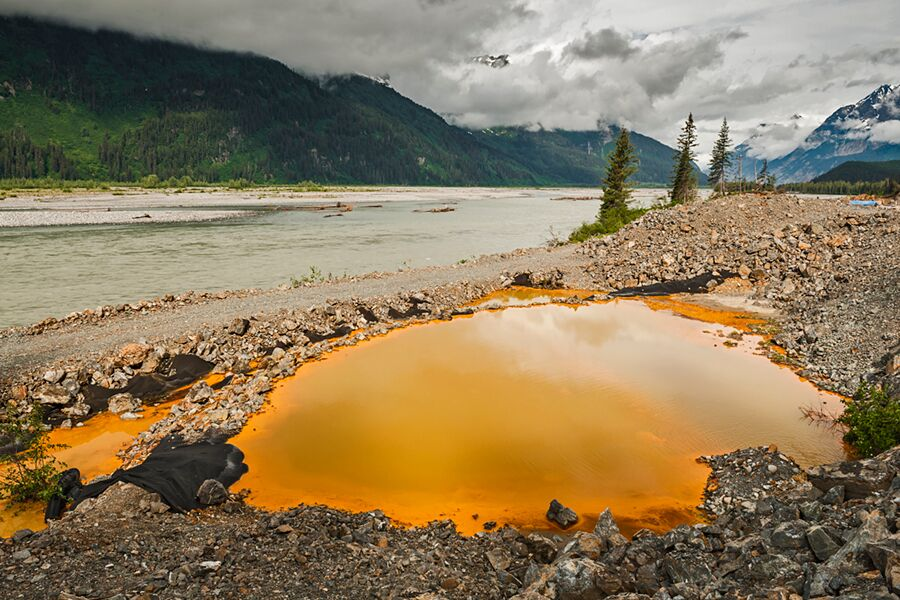 2013-acid-drainage-from-the-tulsequah-chief-mine-discolors-a-leaking-containment-pond-next-to-the-tulsequah-river-in-british-columbia-chris-miller-tu