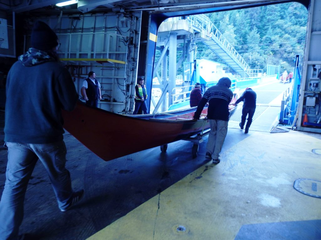 Price and volunteers rolled the canoes off of the ferry on trailers. (Photo by Abbey Collins/KHNS)