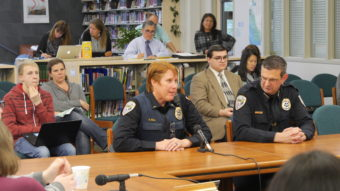 JPD Lt. Kris Sell (left) and Chief Bryce Johnson (right) speak at Tuesday's Juneau School Board meeting. (Photo by Quinton Chandler/KTOO)