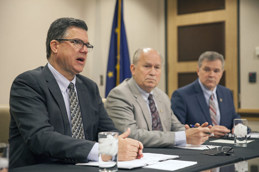 Alaska Gasline Development Corporation President Keith Meyer, Alaska Gov. Bill Walker and Department of Natural Resources Commissioner Andy Mack discuss meetings with potential buyers of Alaska's LNG during a press conference on Friday Sept. 30, 2016 in Anchorage, Alaska. (Photo by Rashah McChesney)