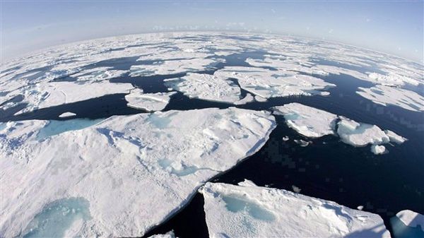 Ice floes float in Baffin Bay between Canada and Greenland above the Arctic circle on July 10, 2008. The seven lowest levels of sea ice cover have all been recorded in the last seven years. (Photo by Jonathan Hayward, Canadian Press.)