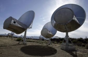 Radio telescopes of the Allen Telescope Array are seen in Hat Creek, Calif. A signal that intrigued scientists has been found to have its roots on Earth, Russian scientists say. (Photo by Ben Margot/Associated Press)