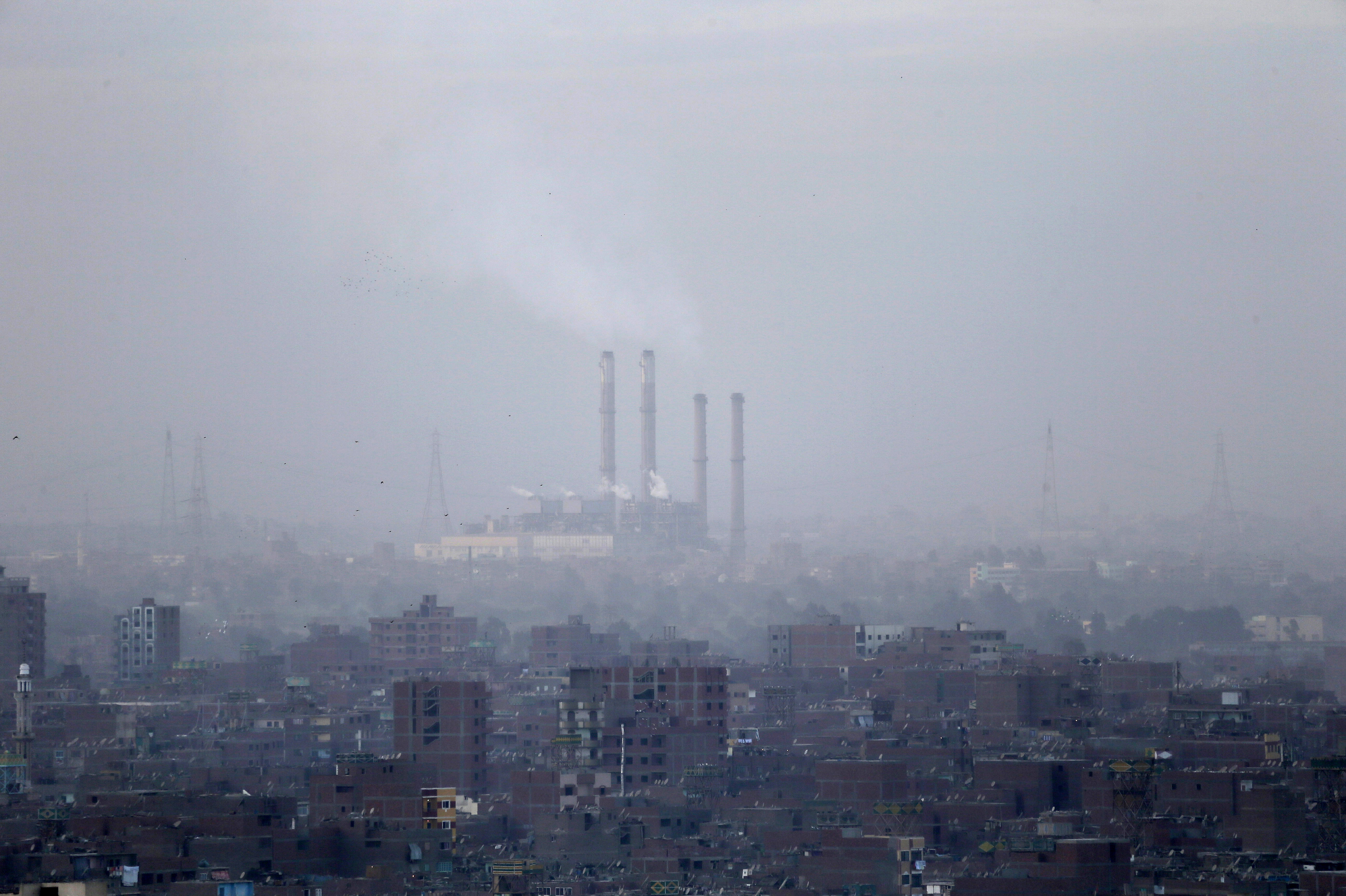 Smog blankets Cairo, Egypt, in 2012. (Photo by Hassan Ammar/Associated Press)