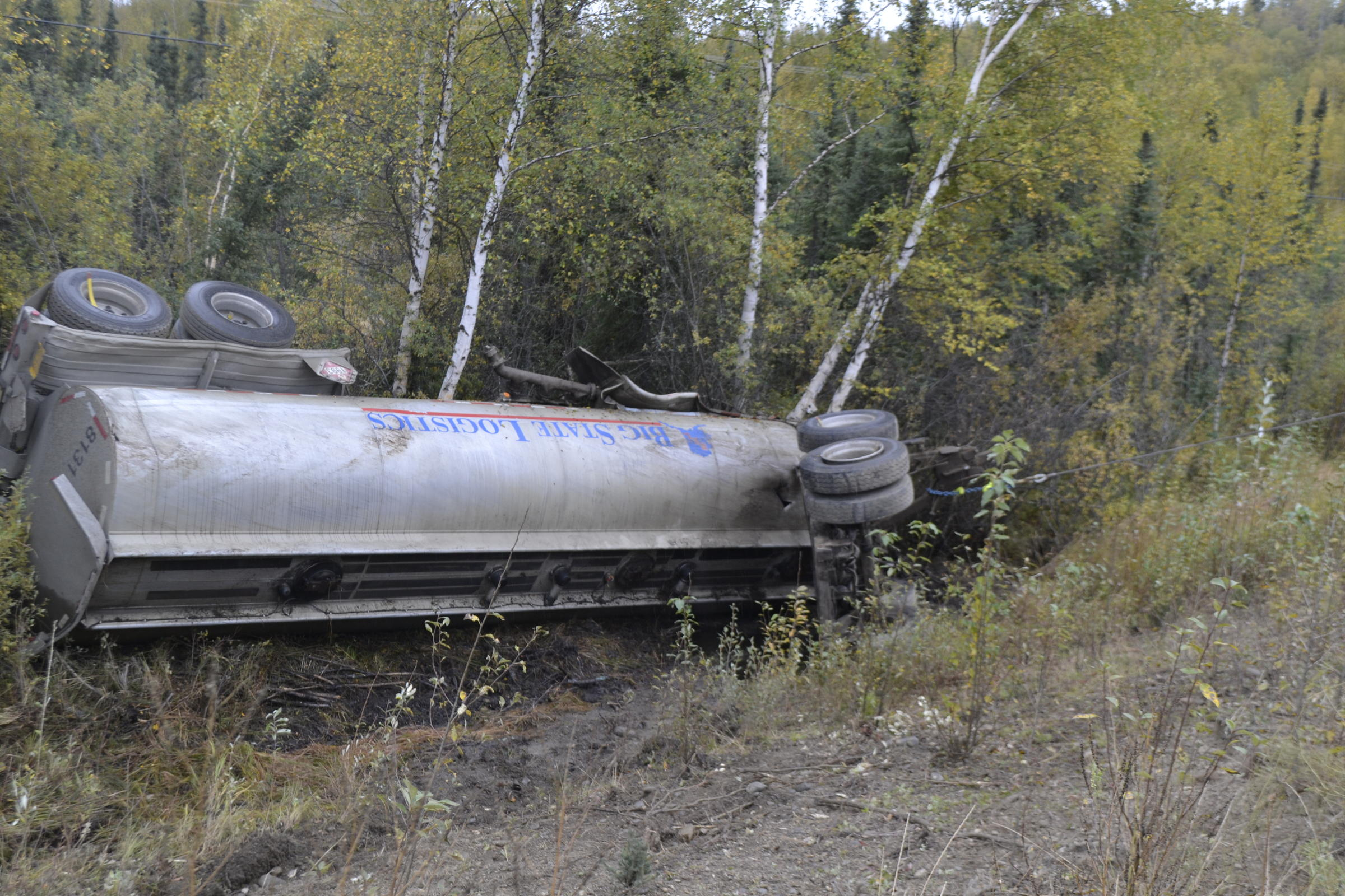 Investigators say multiple punctures enabled most of the 5,000 gallons of diesel fuel in this tanker to quickly leak out after it overturned Monday near the intersection of Lost Lake Road and the Richardson Highway. (Photo courtesy of Alaska Department of Environmental Conservation)