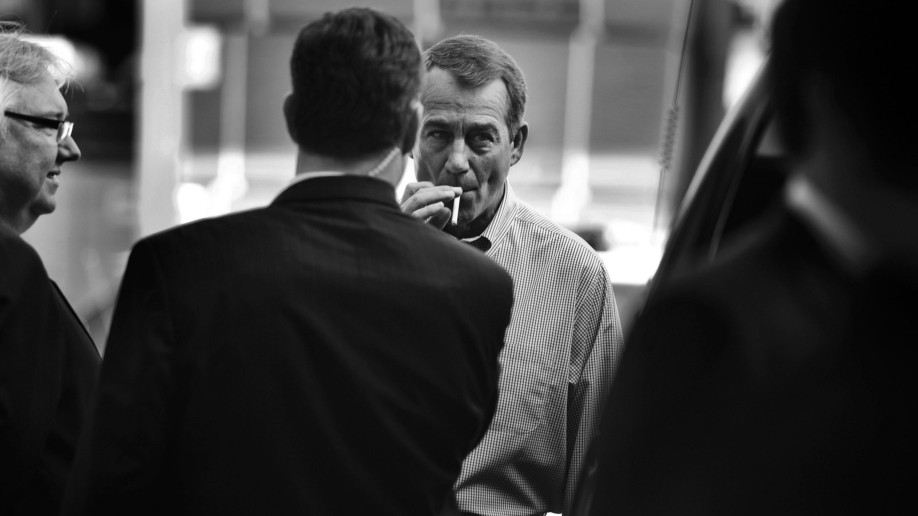 John Boehner smokes a cigarette after a news conference outside of Tart Lumber Company in Sterling, Va., in 2010. (Photo by Tom Williams/Roll Call Photos/Getty Images)