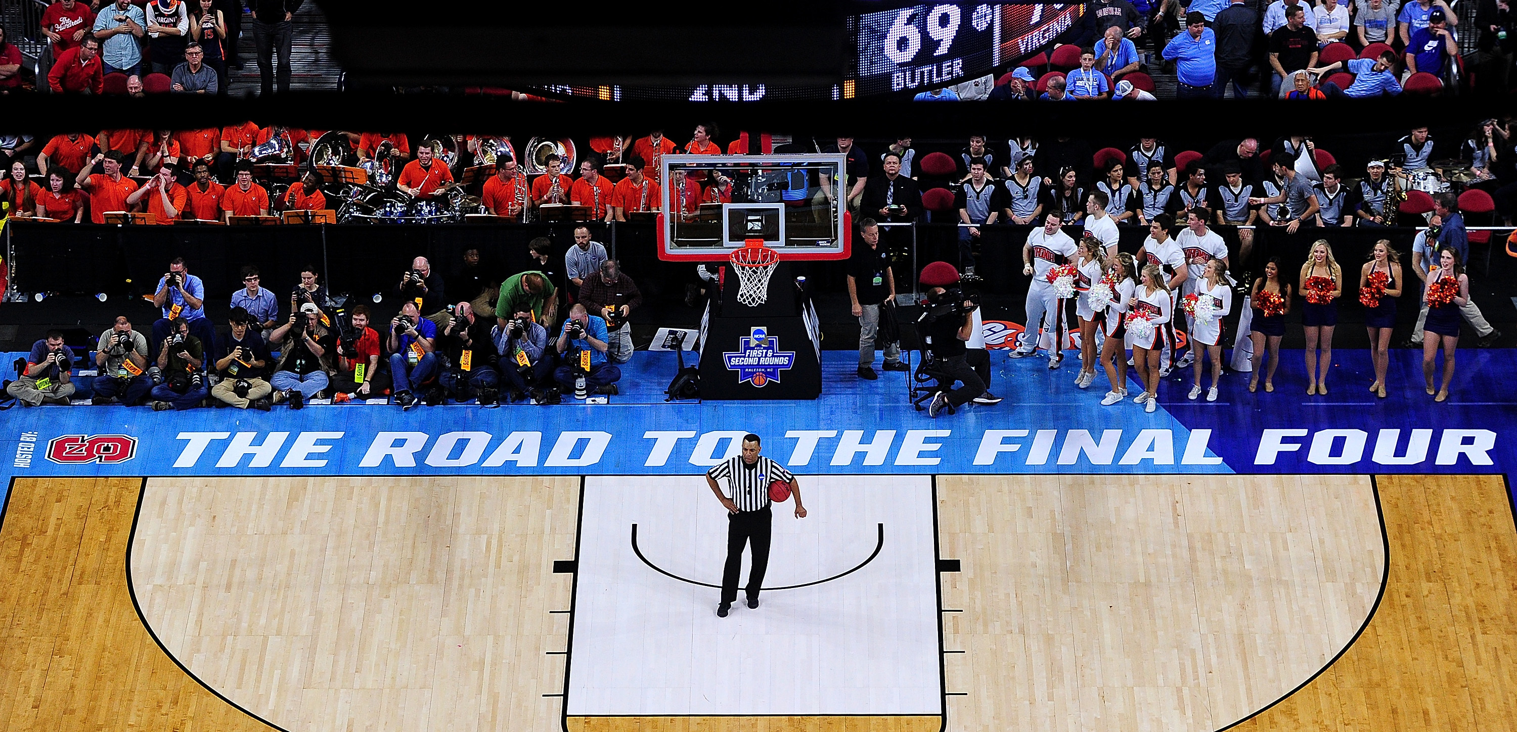 An official and others wait for play to resume during an NCAA Men's Basketball Tournament second-round game between the Butler Bulldogs and the Virginia Cavaliers in March in Raleigh, N.C. This coming spring the Road to the Final Four won't go through North Carolina, as the NCAA has decided to move three games out of Greensboro. (Photo by Grant Halverson/Getty Images)