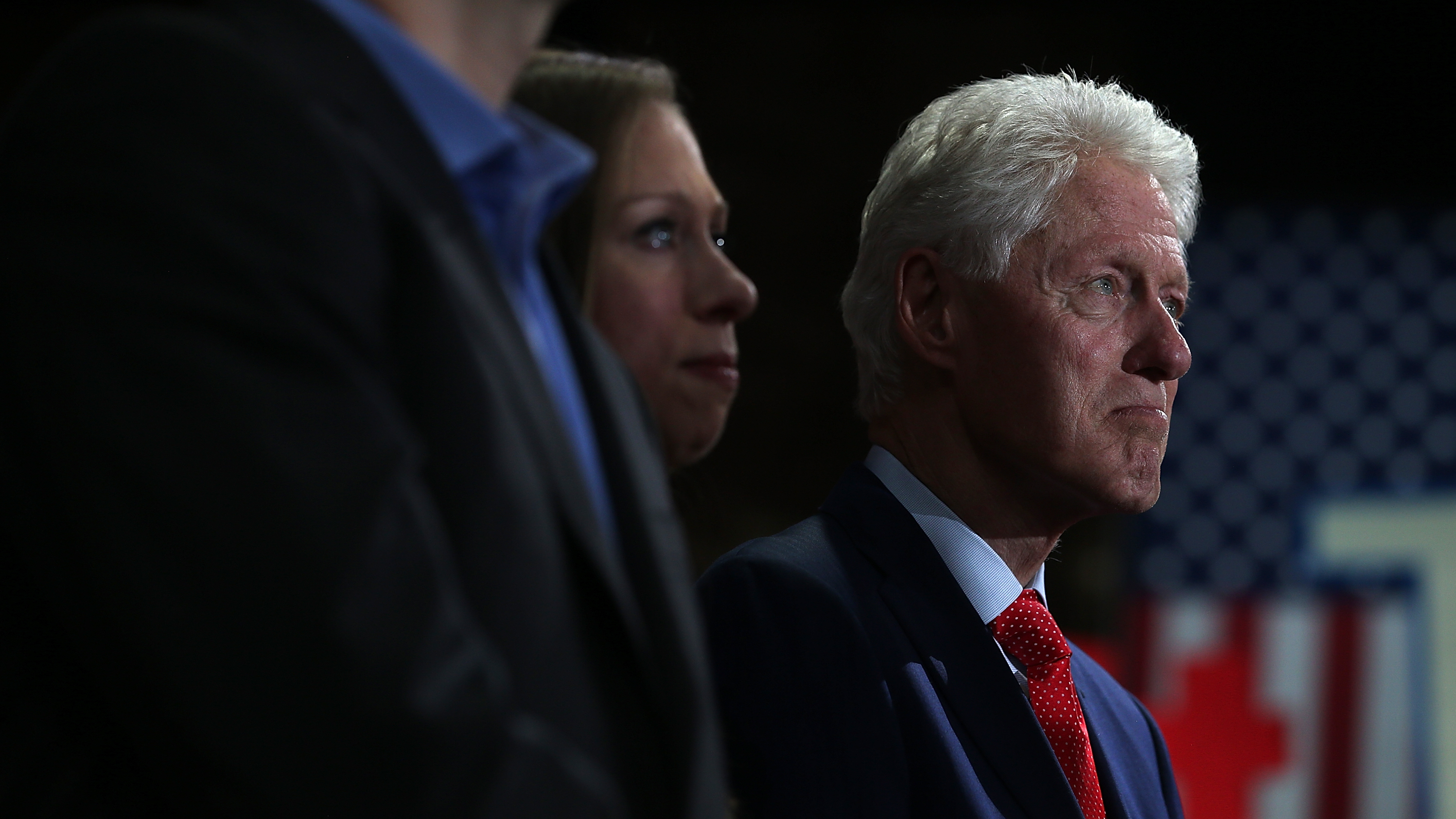 Former president Bill Clinton and his daughter, Chelsea Clinton, watch Hillary Clinton speak during a primary election night gathering April 19 in New York City. (Photo by Justin Sullivan/Getty Images)