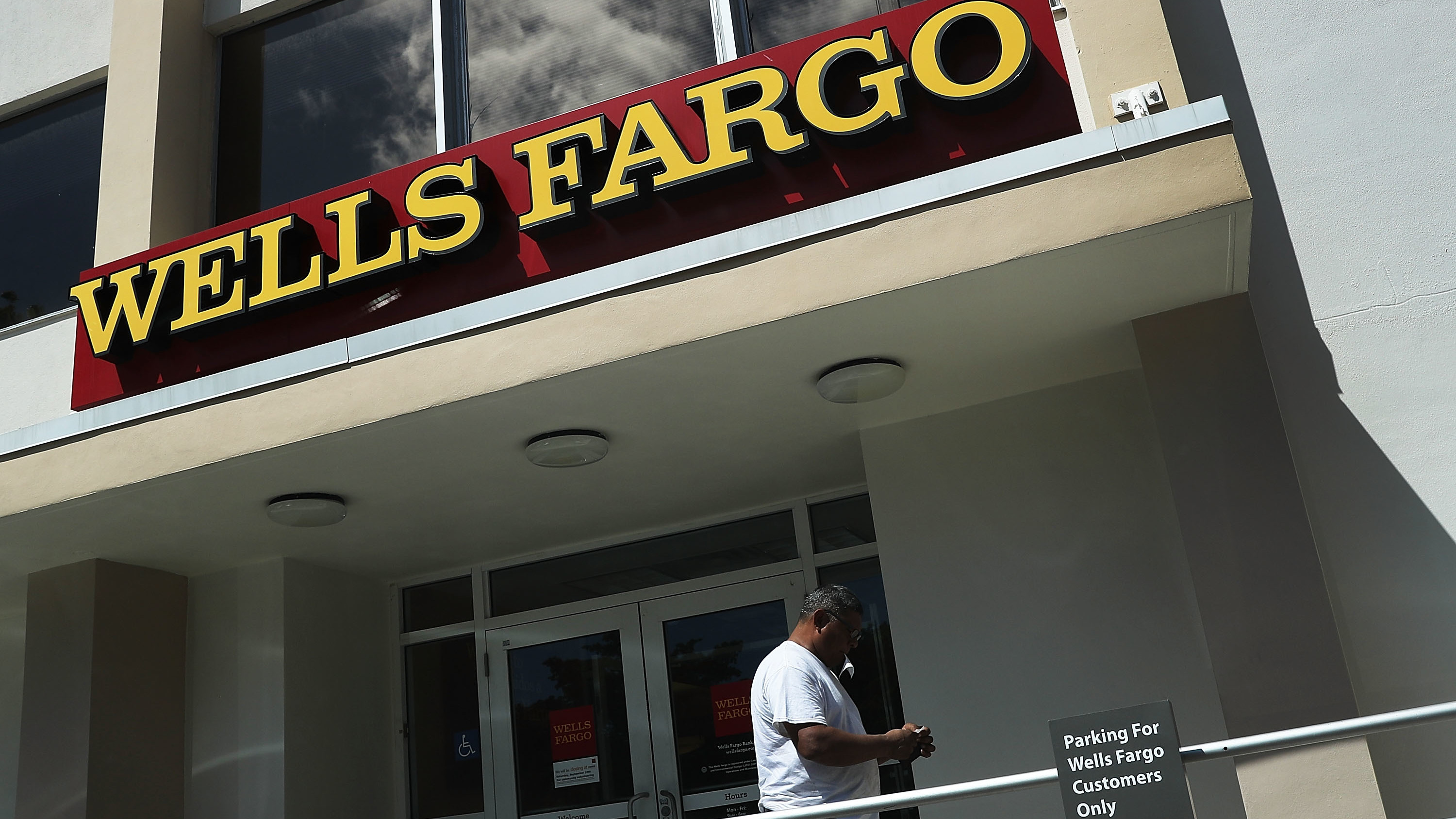A Wells Fargo executive's departure with large stock and options holdings has sparked questions, after the division she ran incurred $185 million in penalties. (Photo by Joe Raedle/Getty Images)