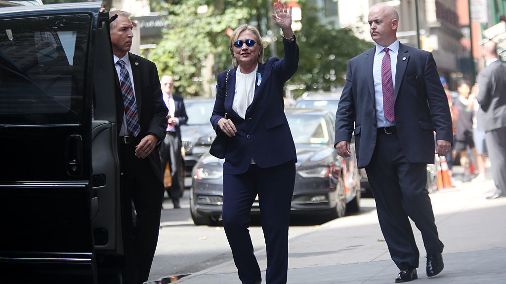 Hillary Clinton exits her daughter Chelsea Clinton's apartment on Sunday after she became sick at a Sept. 11 memorial service. Diagnosed with pneumonia, she had taken several days off the campaign trail to recover. (Photo by Yana Paskova/The Washington Post/Getty Images)