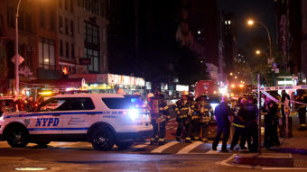 Police officers and firefighters respond to an explosion on Saturday at 23rd Street and 7th Avenue in the Chelsea neighborhood of New York City. Authorities say more than two dozen people have been taken to hospitals with injuries, none of which are thought to be life threatening. Jamie McCarthy/Getty Images