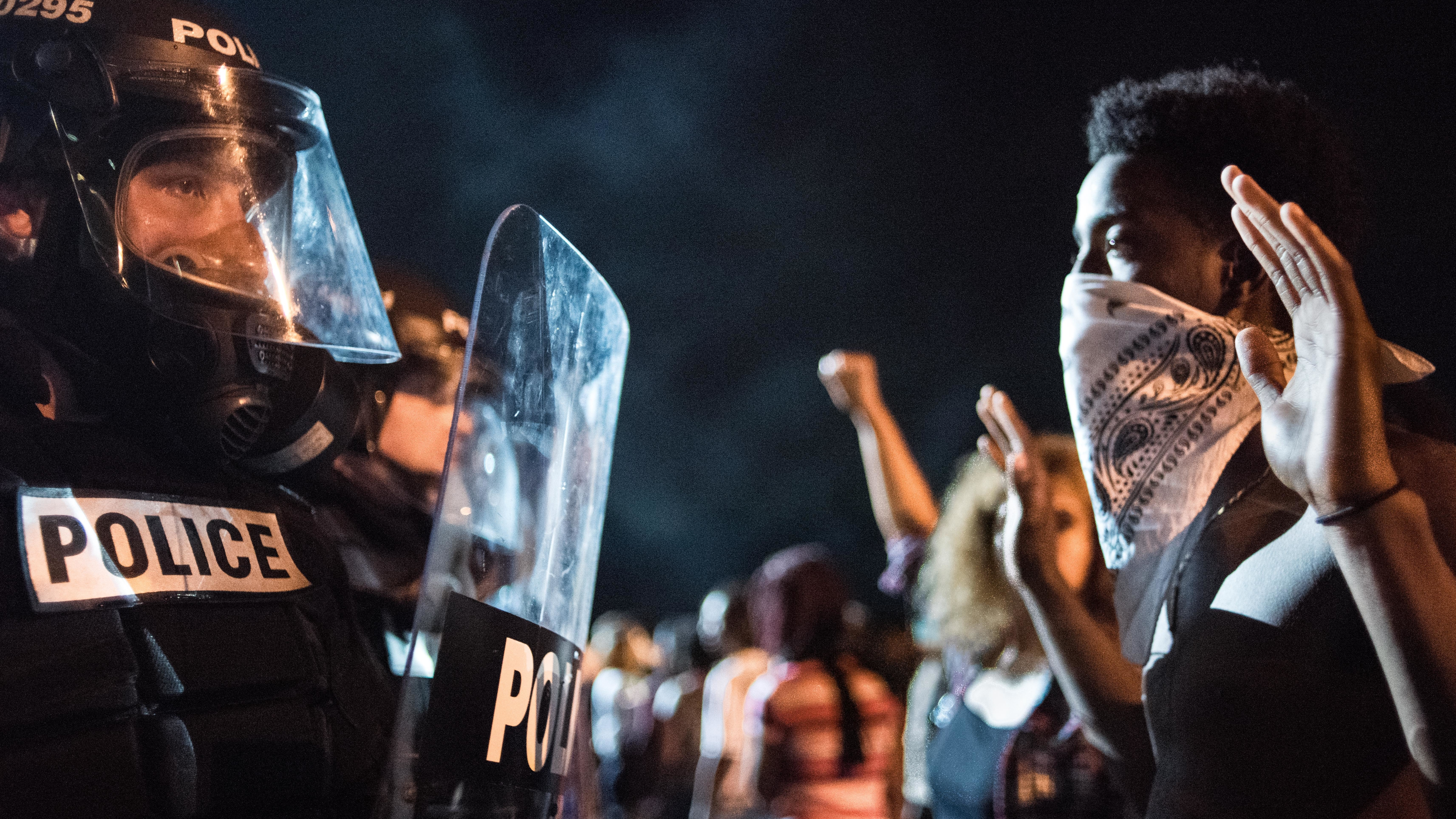 Police officers face off with protesters on Interstate 85 in Charlotte, N.C., during demonstrations following the death of a man shot by a police officer on Tuesday. (Photo by Sean Rayford/Getty Images)