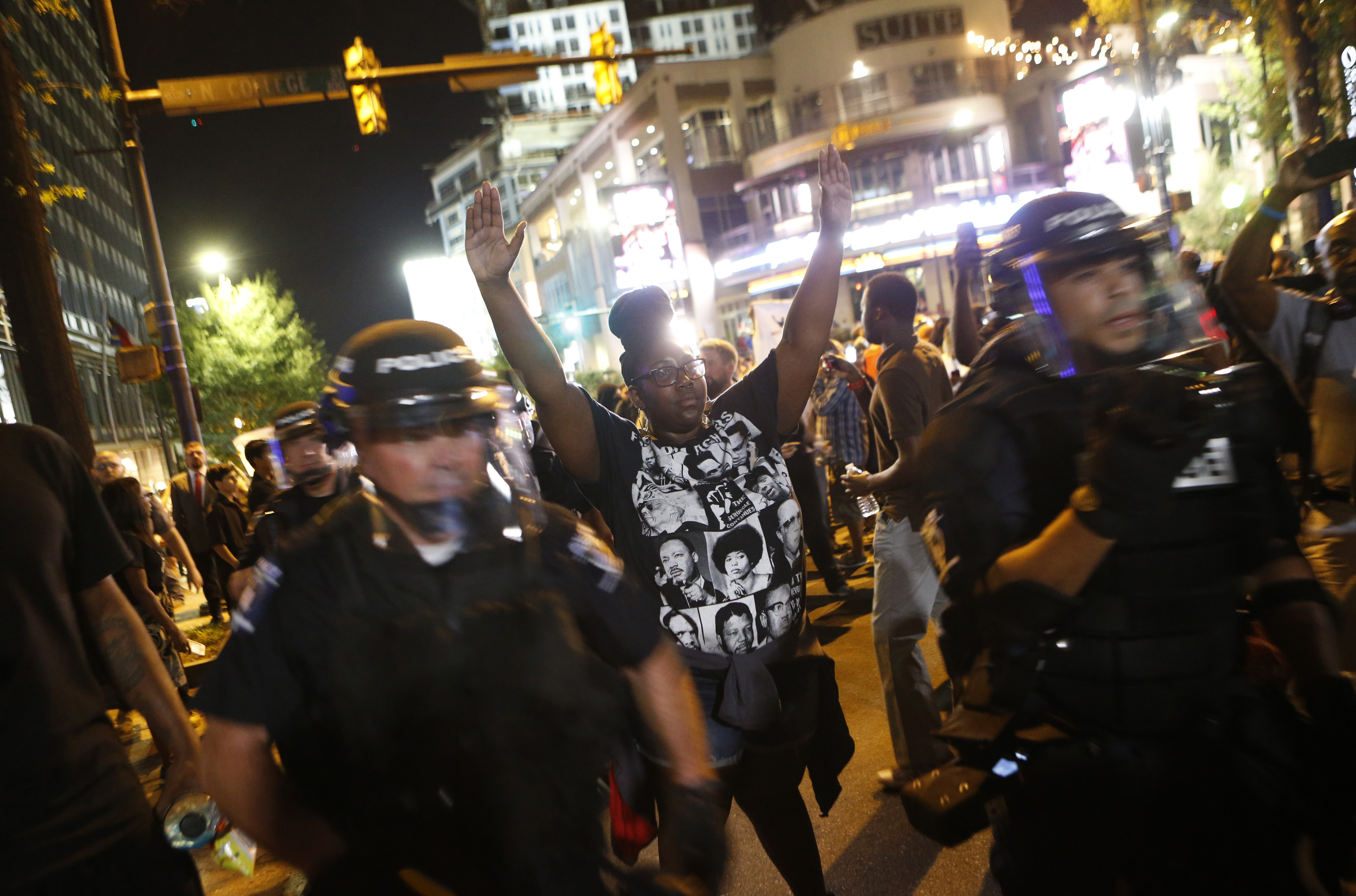 Protesters march Wednesday to protest the Tuesday shooting death of Keith Lamont Scott in Charlotte, N.C. Scott, who was black, was shot and killed by police officers, who say Scott was holding a gun and ignored instructions to drop it. Relatives and neighbors say he was holding a book.