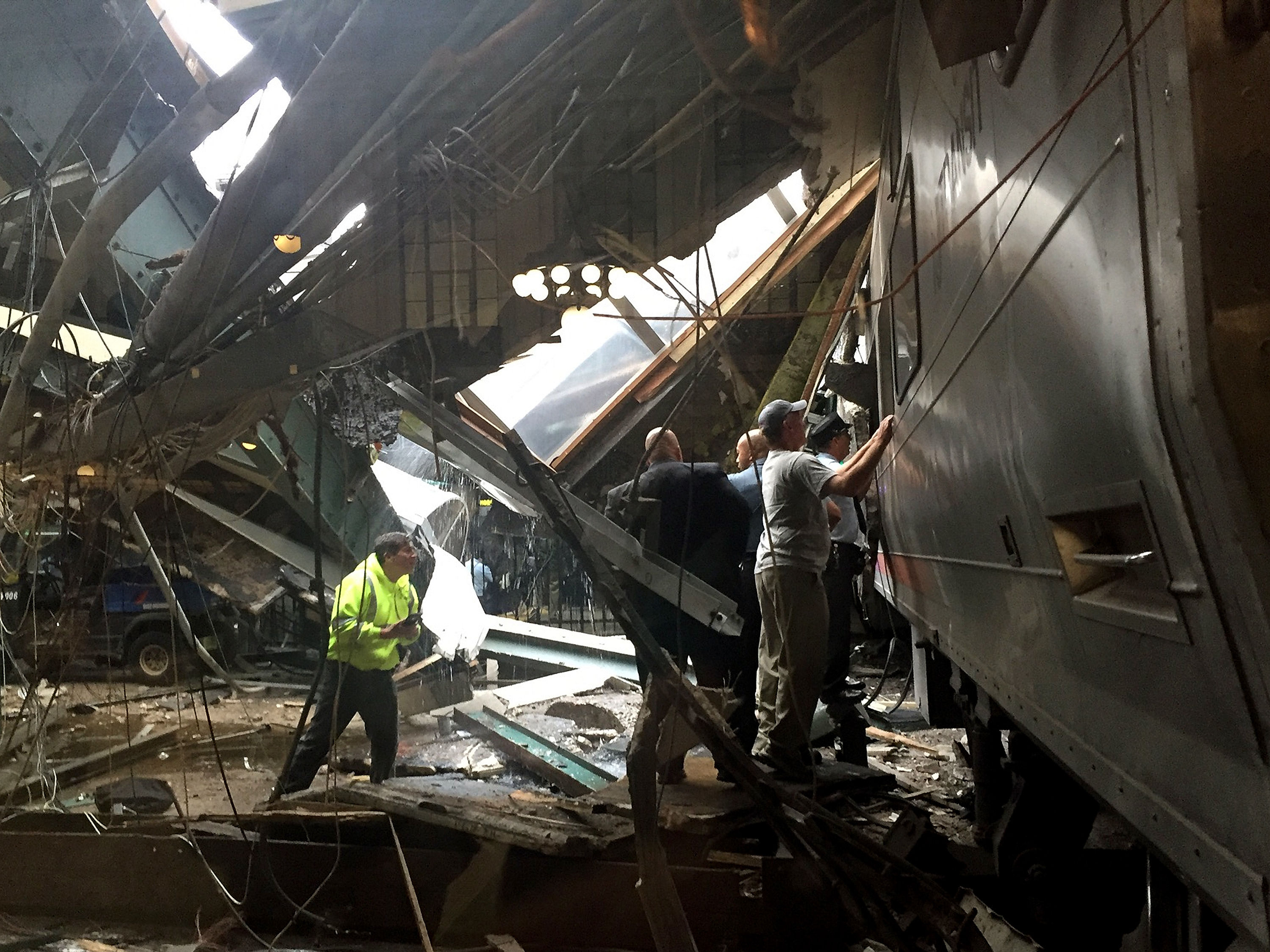 Train personnel survey the New Jersey Transit train that crashed into the platform at Hoboken Terminal on Thursday. (Photo by Pancho Bernasconi/Getty Images)