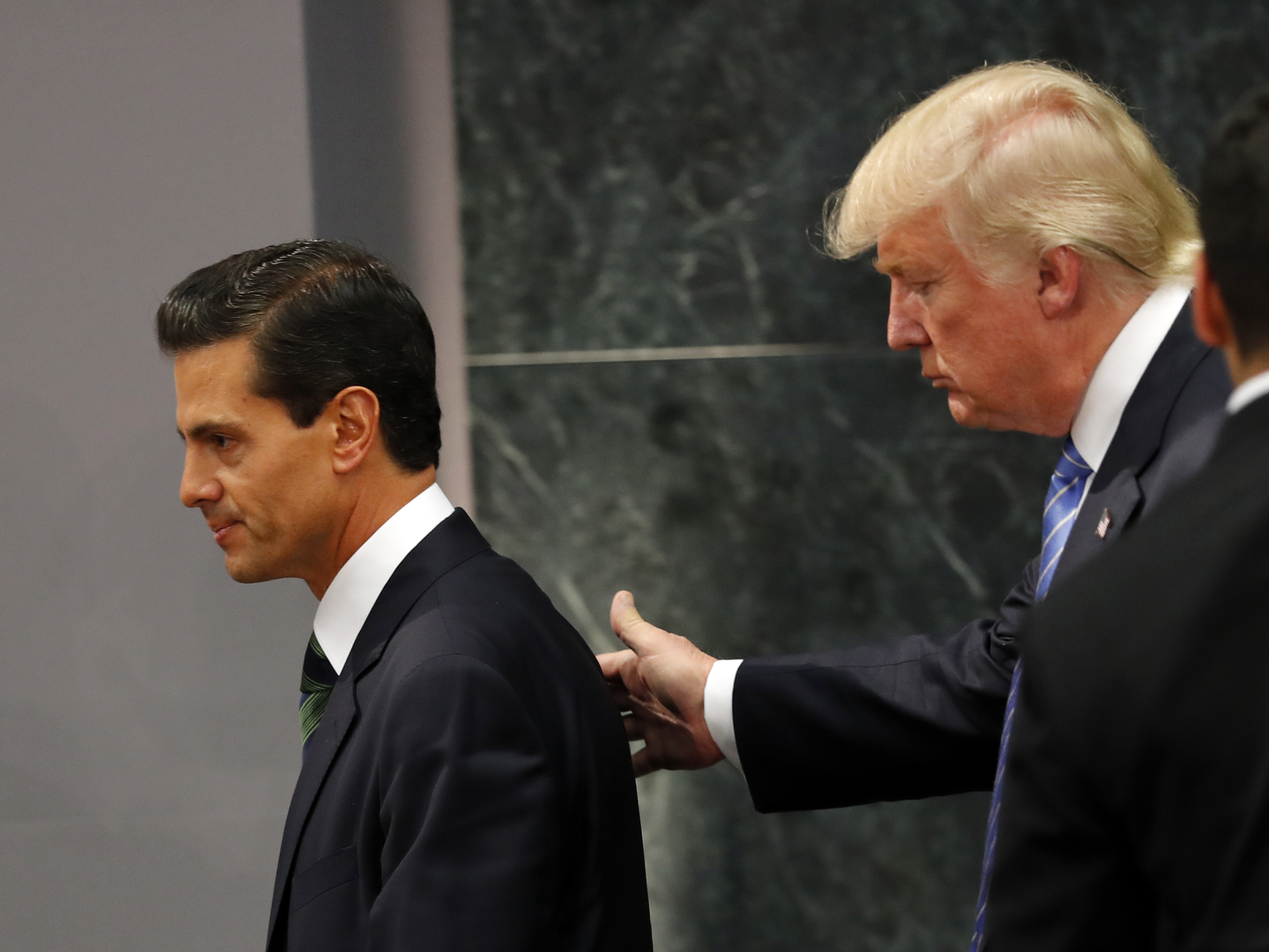 Republican presidential nominee Donald Trump walks with Mexico President Enrique Peña Nieto at the end of their joint statement at Los Pinos, the presidential residence, in Mexico City. (Photo by Dario Lopez-Mills/Associated Press)