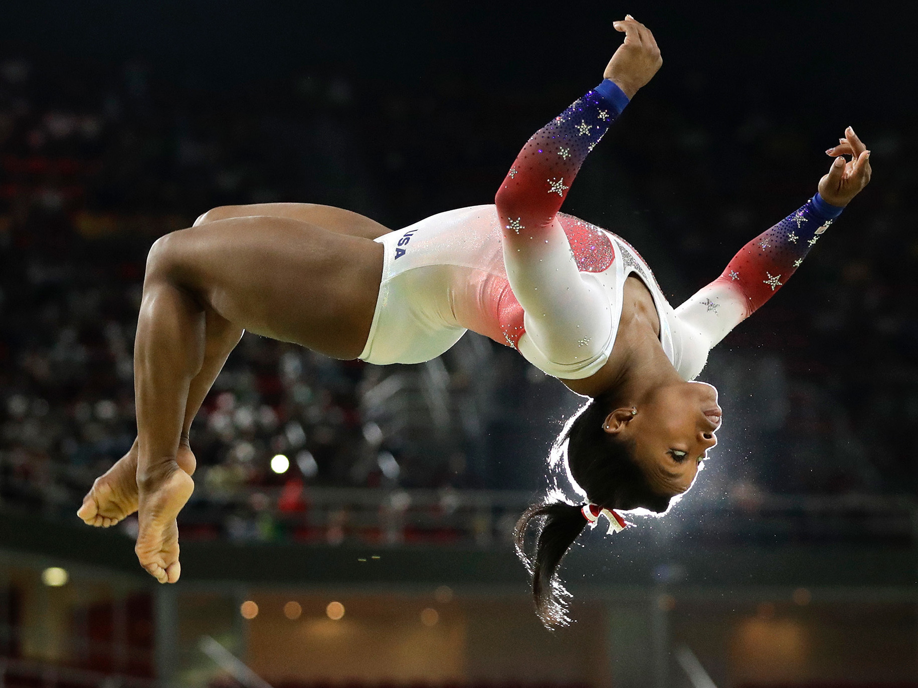Simone Biles flies through the air while performing on the balance beam at the Olympics in Rio de Janeiro. (Photo by Dmitri Lovetsky/Associated Press)