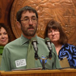 Alaska Mental Health Trust Executive Director Jeff Jessee tells reporters why he supports Gov. Bill Walker's efforts to expand Medicaid at a press conference in the Capitol, March 17, 2015. Gov. Walker had just announced that he had introduced a bill that he hopes will lead to Medicaid overhaul and expansion. (Photo by Skip Gray/360 North)