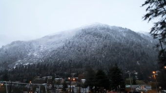 Snow covers Mount Juneau, Sunday, Oct. 16. (Photo by Tripp Crouse/KTOO)