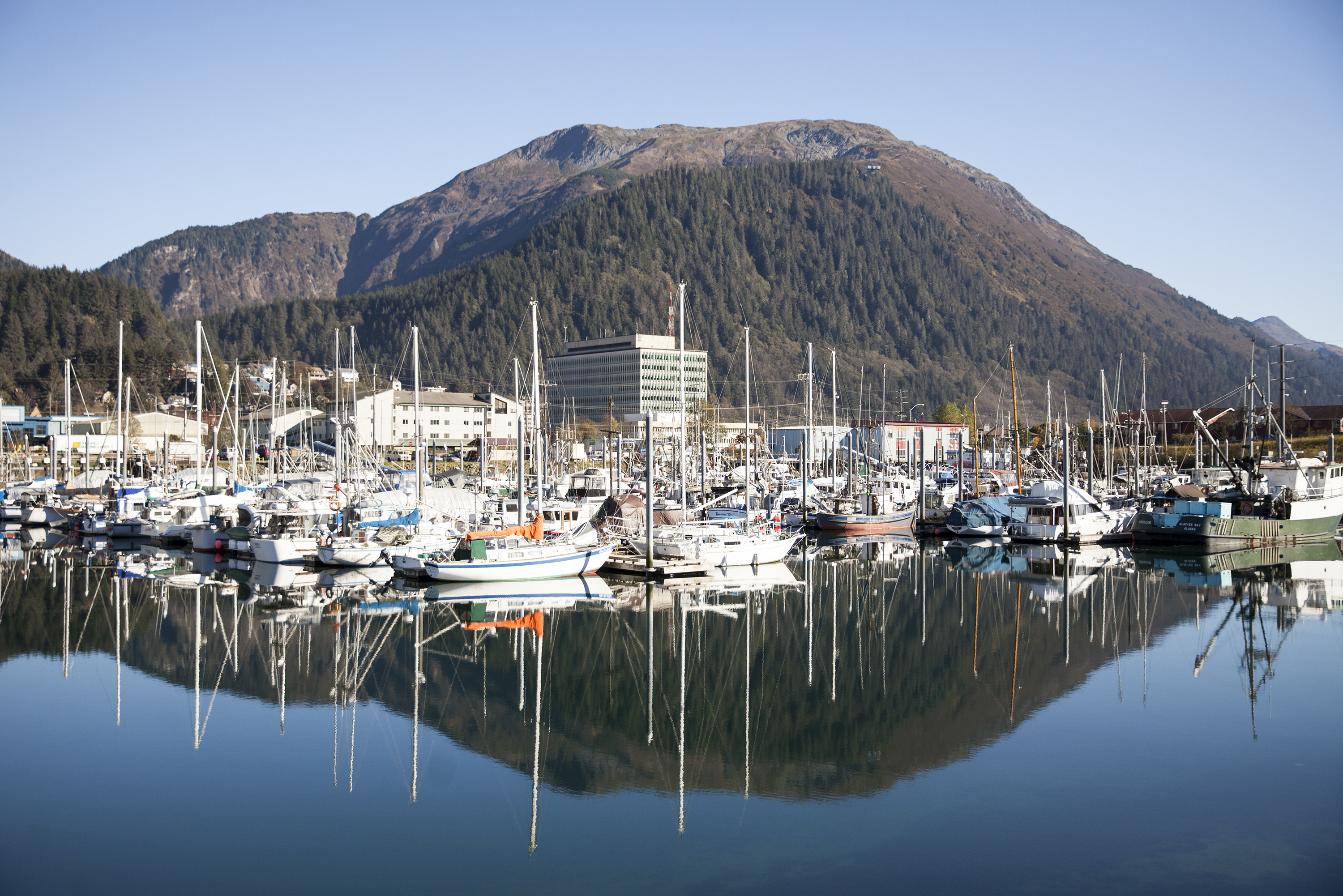 Boats lined up in Harris Harbor on a sunny, clear day Wednesday, Oct. 12, 2016 in downtown Juneau, Alaska.  (Photo by Rashah McChesney/Alaska's Energy Desk)