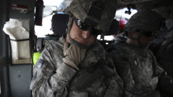 The Pentagon is seeking millions of dollars from nearly 10,000 current or former soldiers in the California National Guard, saying they didn't deserve reenlistment bonuses. Here, soldiers from the state's Guard force are seen in 2010, resting during transport in northeastern Afghanistan.