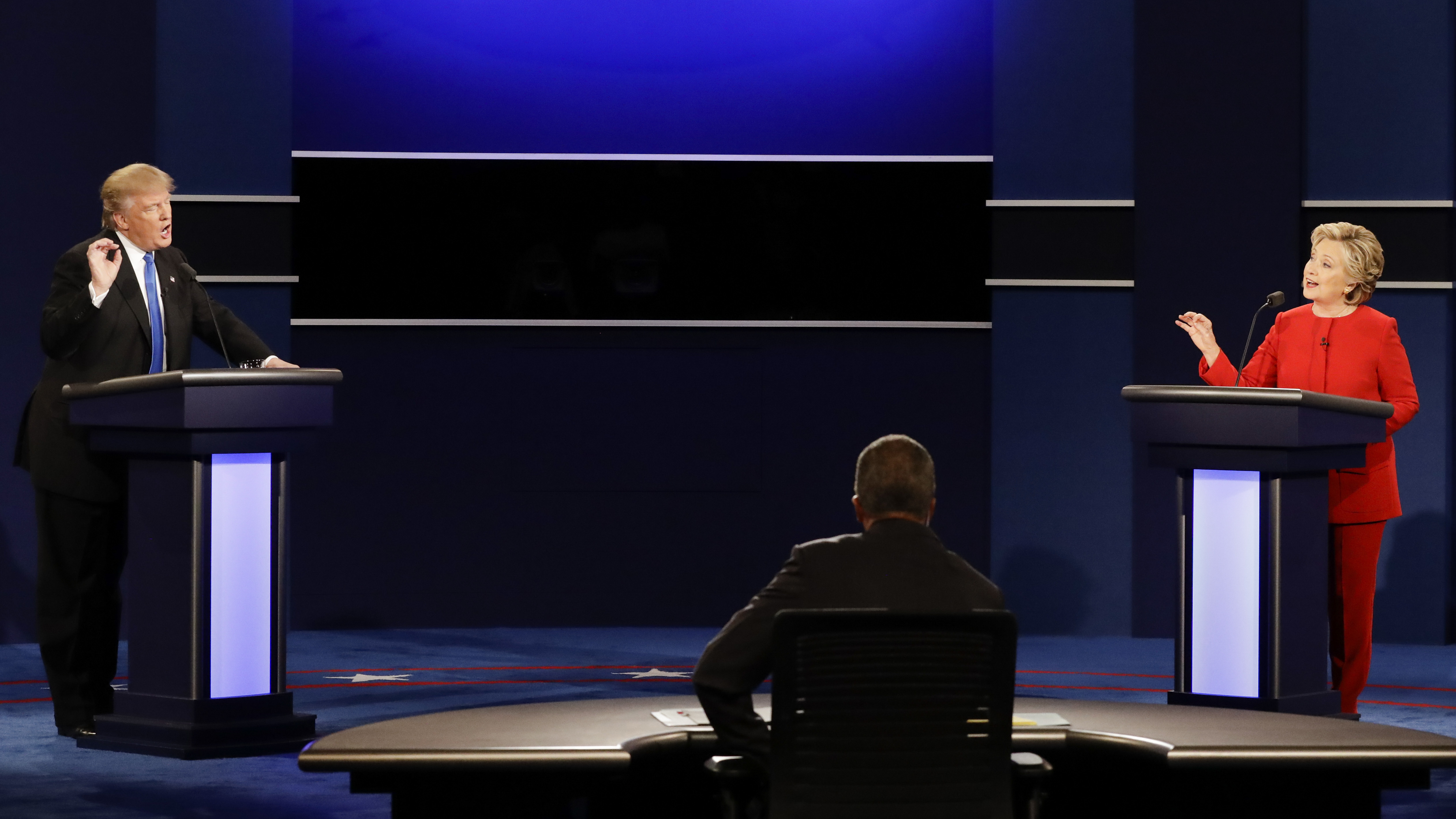 Republican presidential nominee Donald Trump and Democratic presidential nominee Hillary Clinton spar during the first presidential debate of 2016. (Photo by David Goldman/Associated Press)