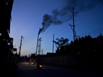 The smokestack of a factory on the outskirts of Gauhati, India, on Sunday. Anupam Nath/AP