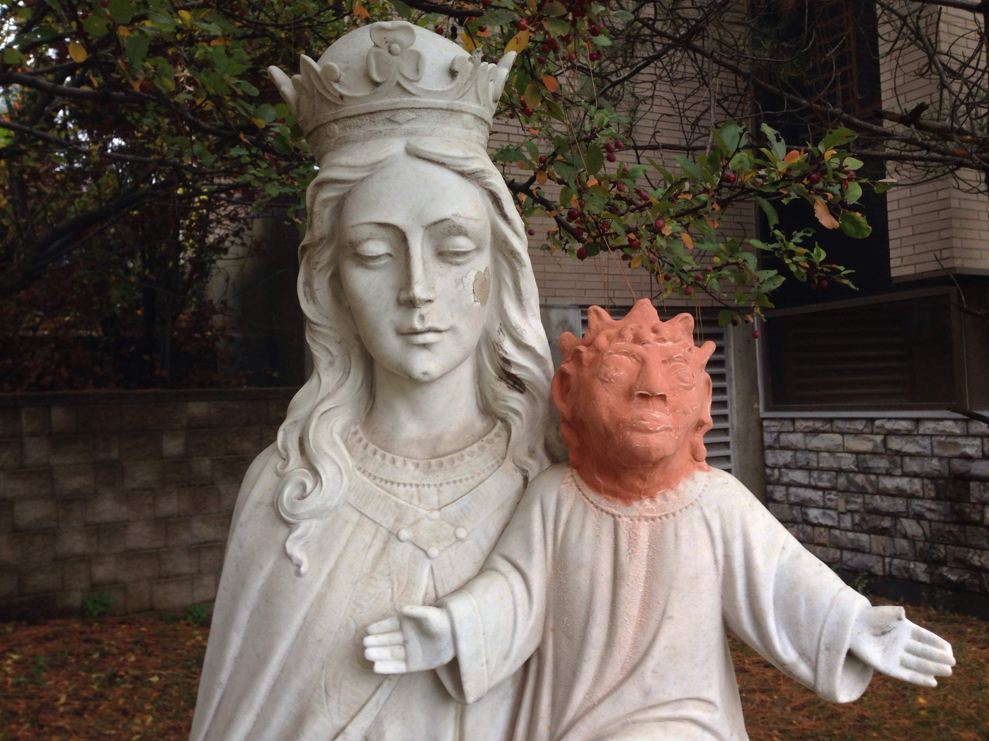 This statue, in Sudbury, Ontario, was apparently vandalized about a year ago. A local artist volunteered to help replace Jesus' missing head, but not everyone appreciates her efforts. Marina von Stackelberg/CBC