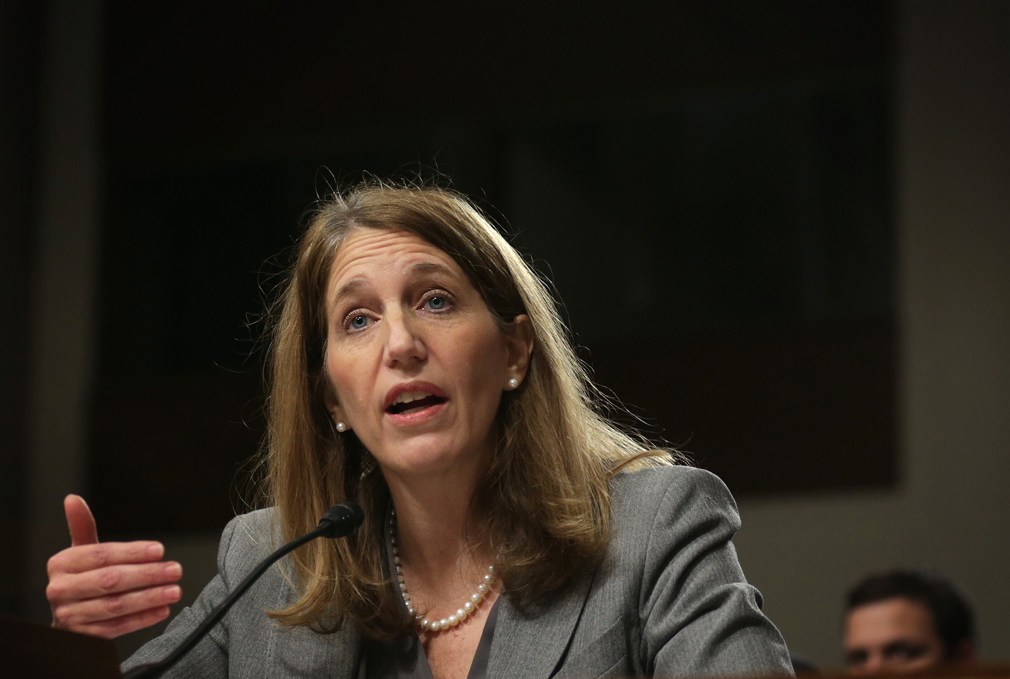 "Secretary of Health and Human Services Sylvia Burwell at a Senate hearing in 2014. ""We expect this to be a transition period for the marketplace,"" she told reporters Wednesday. ""Issuers are adjusting their prices, bringing them in line with actual data on costs."" Alex Wong/Getty Images"