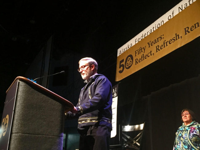 The Presbyterian Church's Curt Karns read an apology before hundreds gathered for the Alaska Federation of Natives Convention in Fairbanks, Alaska. (Photo by Emily Schwing/Northwest News Network)