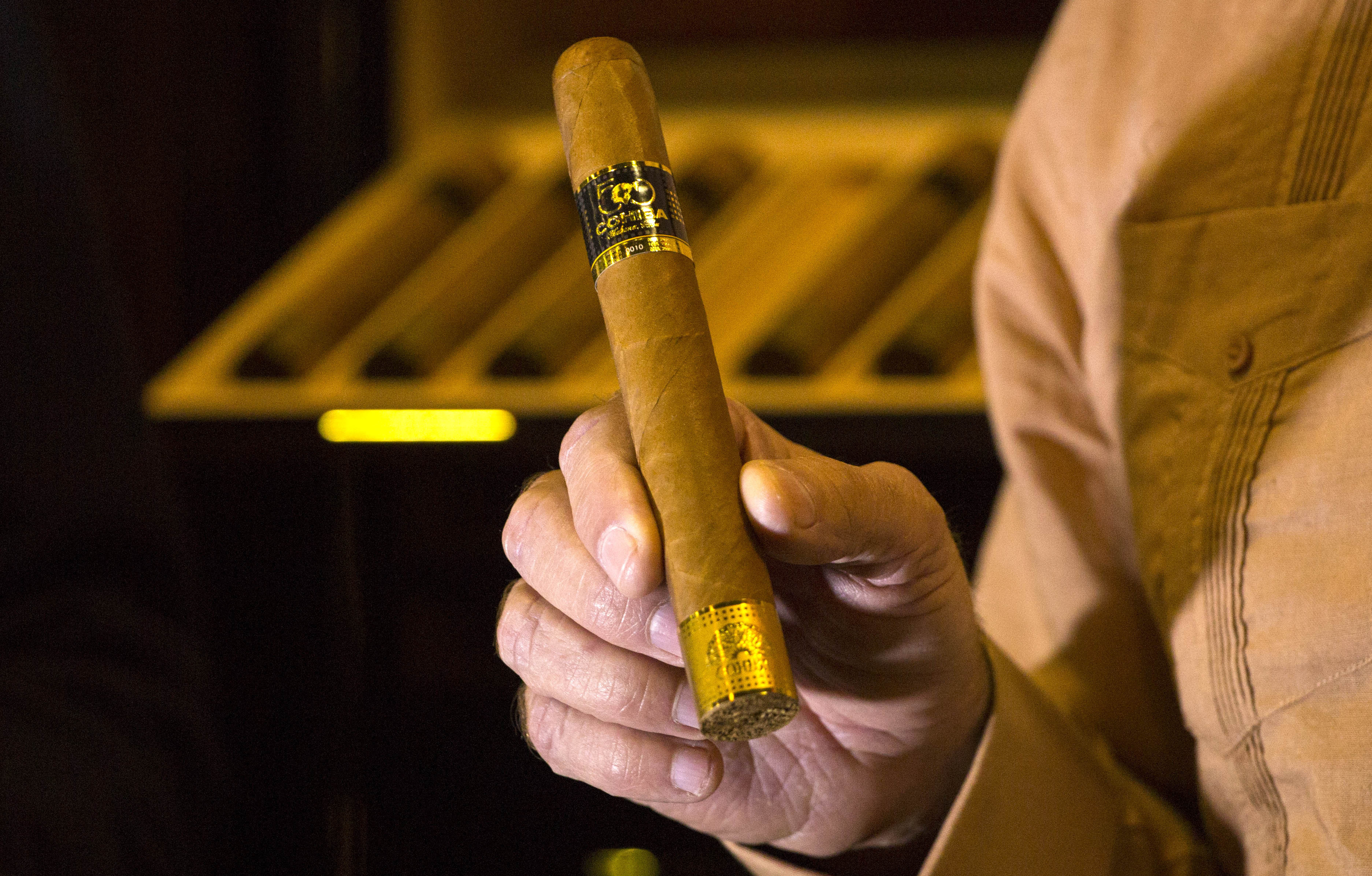 An official displays a limited edition Cohiba 50 cigar, one of 2,000 made for the 50th anniversary of the Cuban brand, on the opening day of the annual Havana Cigar Festival in Havana, Cuba, in February.