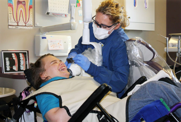 Lindsay Klecker has her teeth cleaned by Beth Rown, a dental hygenist who cares for patients with special needs. (Photo by Alison Kodjak/NPR)