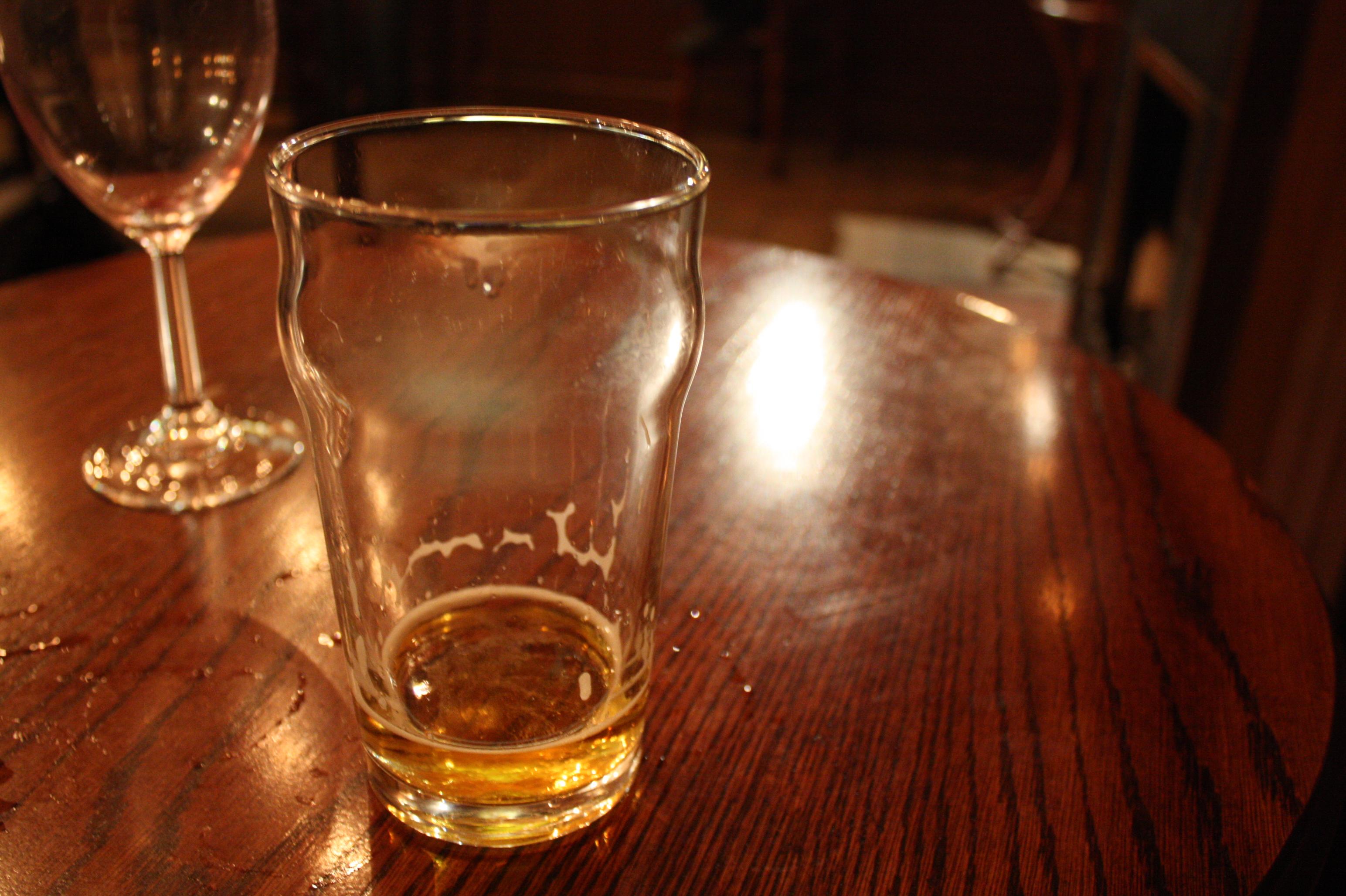 empty pint glass at bar