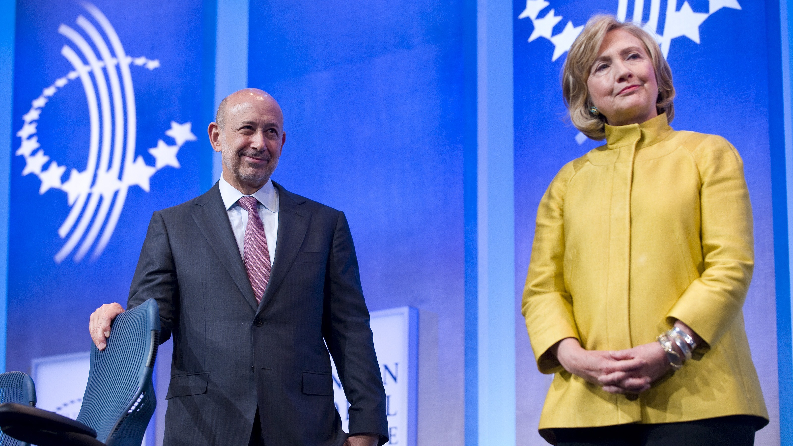 Goldman Sachs Chairman & CEO Lloyd Blankfein stands with Hillary Clinton during the 2014 Clinton Global Initiative meeting in New York on Sept. 24, 2014. Stephen Chernin/AFP/Getty Images